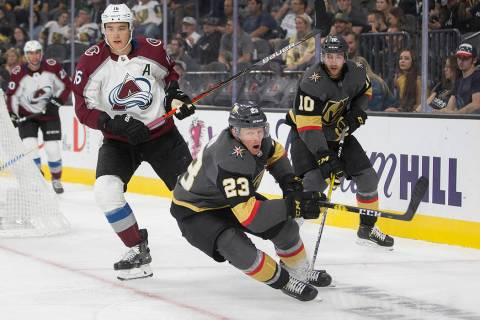 Vegas Golden Knights center Patrick Brown (23) and Vegas Golden Knights center Nicolas Roy (10) ...