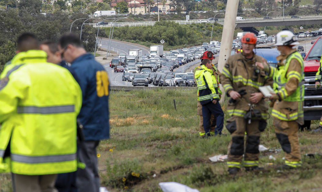 Southbound traffic backed up after a bus rolled down an embankment off Interstate 15 in North S ...