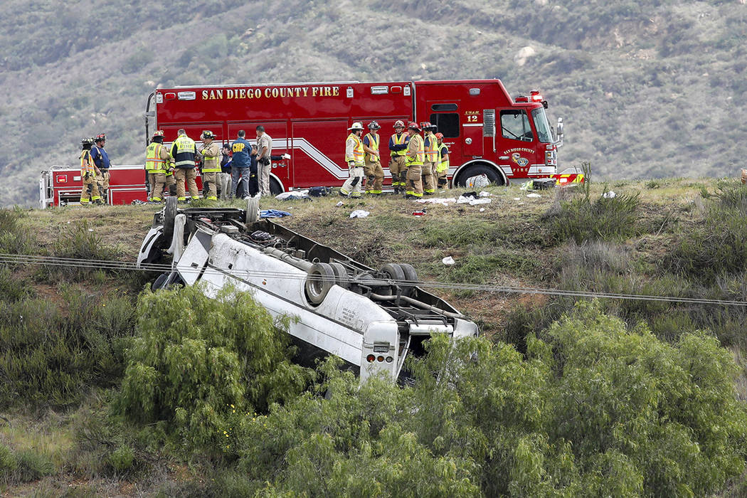 A bus rolled down an embankment off Interstate 15 in North San Diego County Saturday, Feb. 22, ...