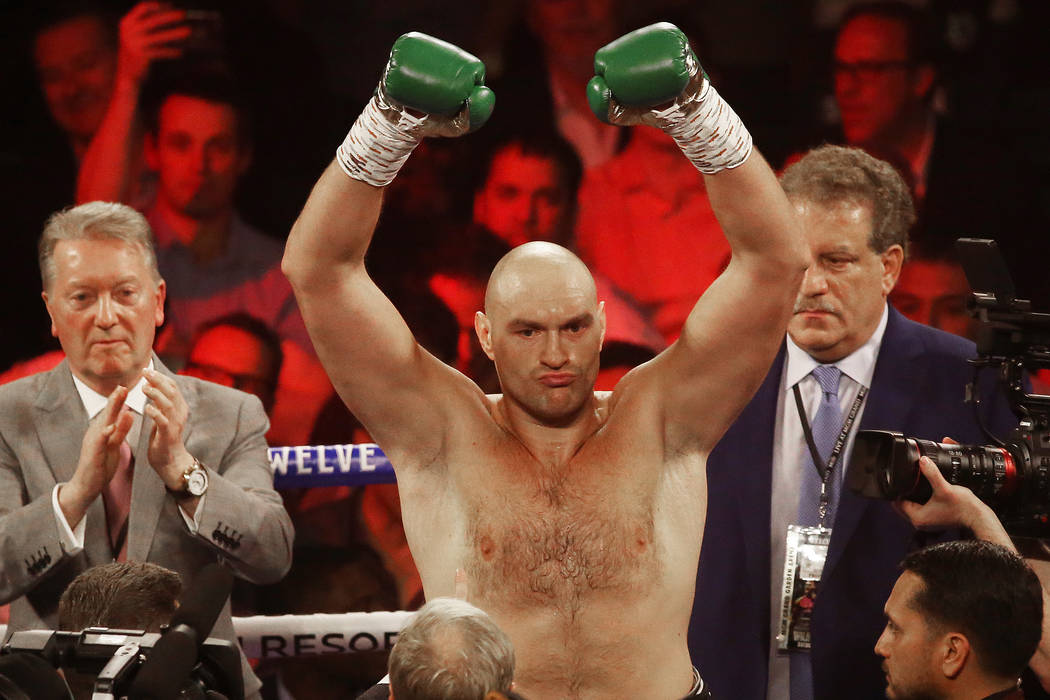 Tyson Fury is announced before the start of his WBC heavyweight title fight with Deontay Wilder ...