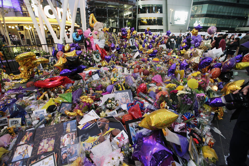 Fans gather at a memorial for the late Kobe Bryant in front of Staples Center in Los Angeles, S ...