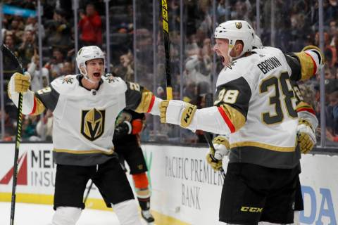 Vegas Golden Knights center Patrick Brown, right, celebrates with defenseman Nick Holden, left, ...