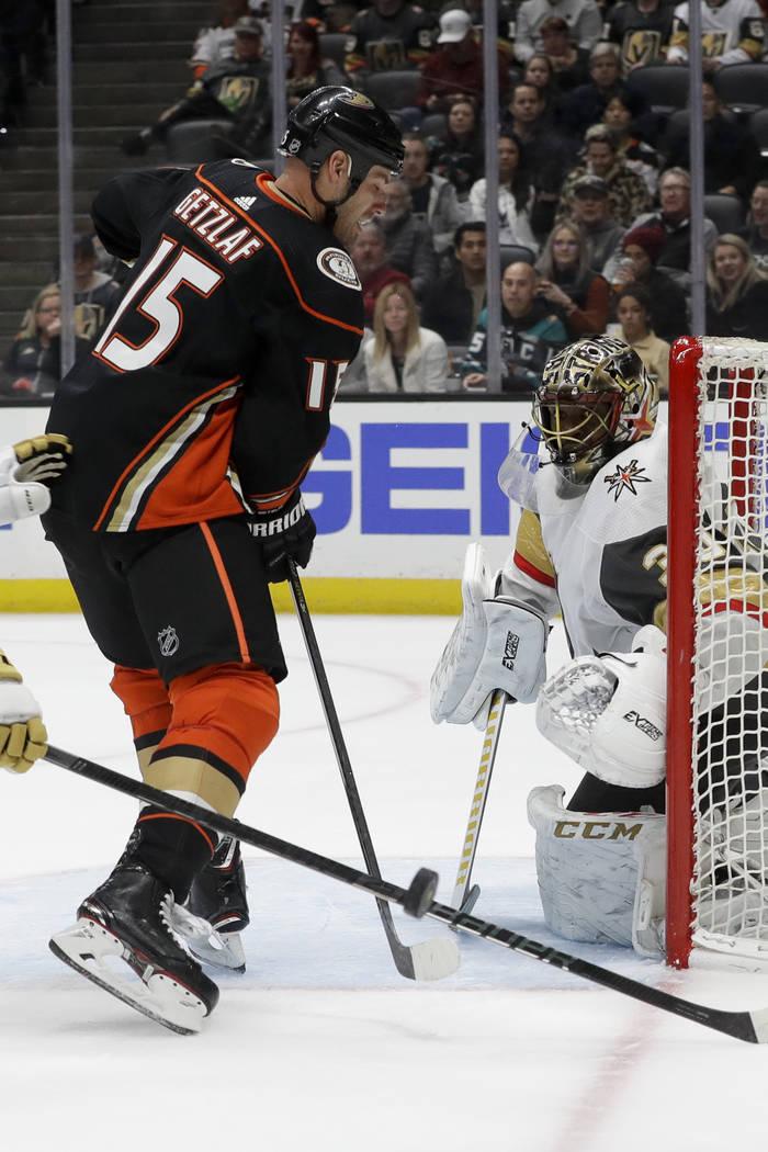 Vegas Golden Knights goaltender Malcolm Subban, right, blocks a shot by Anaheim Ducks center Ry ...