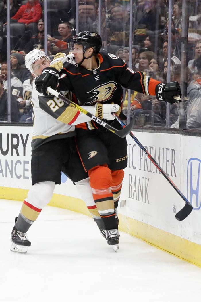 Vegas Golden Knights center Paul Stastny, left, checks Anaheim Ducks defenseman Hampus Lindholm ...