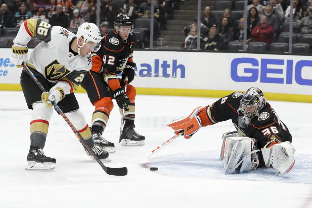Anaheim Ducks goaltender John Gibson, right, blocks a shot by Vegas Golden Knights center Paul ...