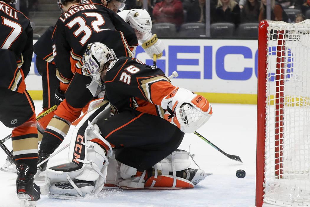Vegas Golden Knights center Patrick Brown (38) scores past Anaheim Ducks goaltender John Gibson ...