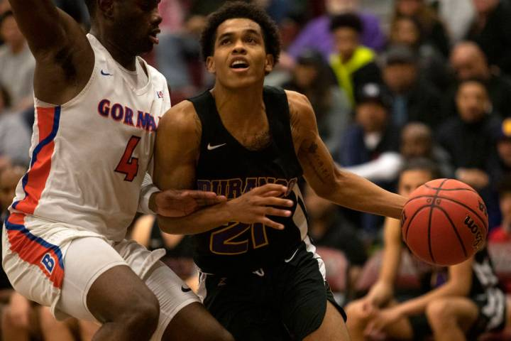 Bishop Gorman's Jonathan Braggs (4) defends against Durango's Anthony Hunter (21) at Desert Oas ...
