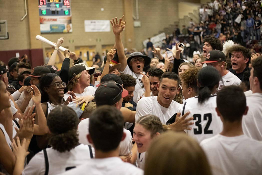 Desert Oasis fans storm the court after their girls basketball team won 67-55 against Spring Va ...