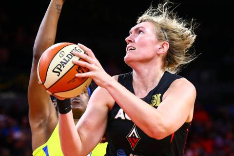Las Vegas Aces' Carolyn Swords goes to the basket against Dallas Wings' Kaela Davis during the ...