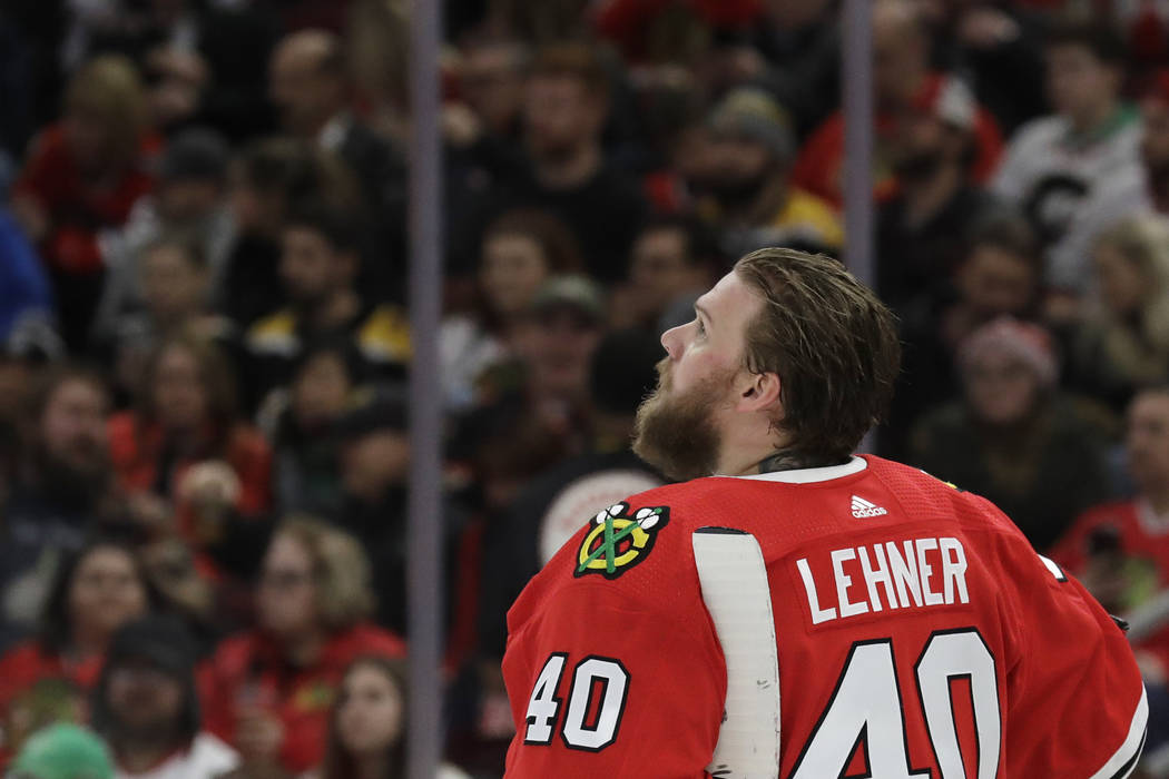 Chicago Blackhawks goalie Robin Lehner looks up the score board during the first period of an N ...