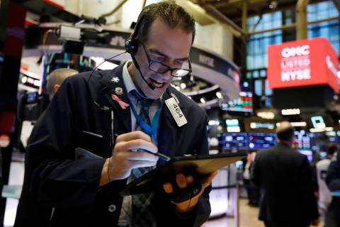 Trader Gregory Rowe works on the floor of the New York Stock Exchange, Monday, Feb. 24, 2020. S ...