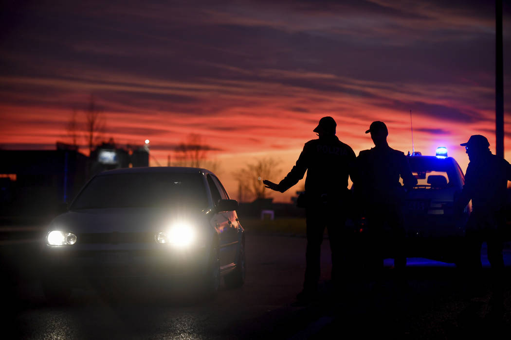 Police stops cars trying to enter or leave the cordoned area in Casalpusterlengo, Northern Ital ...