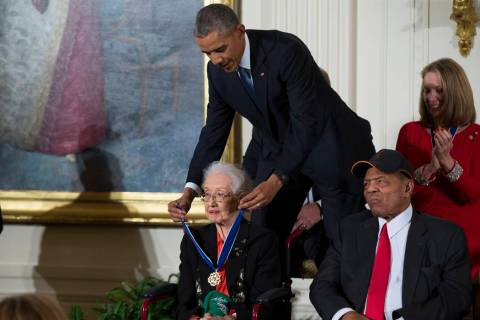 In a Nov. 24, 2015, photo, Willie Mays, right, looks on as President Barack Obama presents the ...