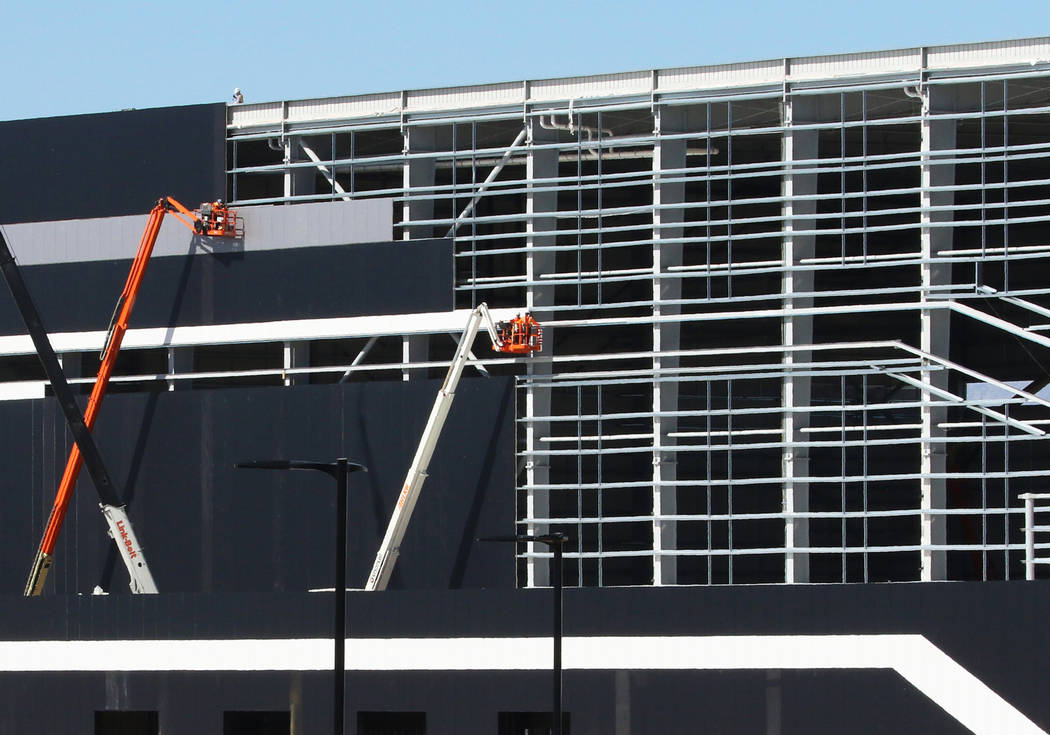 Workers are seen at the Raiders' under-construction practice facility in Henderson on Monday, F ...