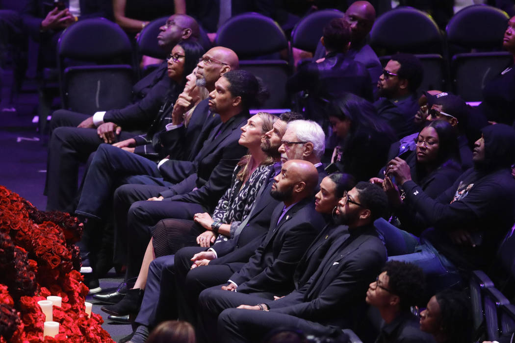 Former Los Angeles Lakers watch during a celebration of life for Kobe Bryant and his daughter G ...