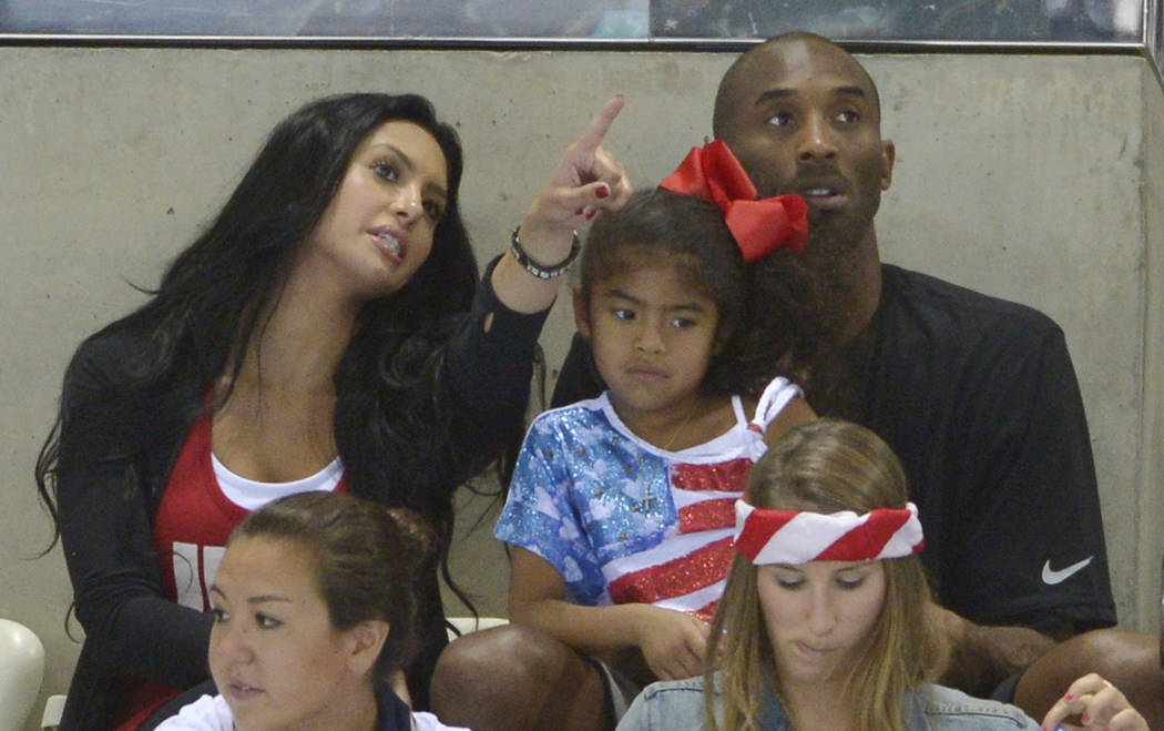 Kobe Bryant with his wife, Vanessa, and daughter Gianna prepare to watch the final night of swi ...