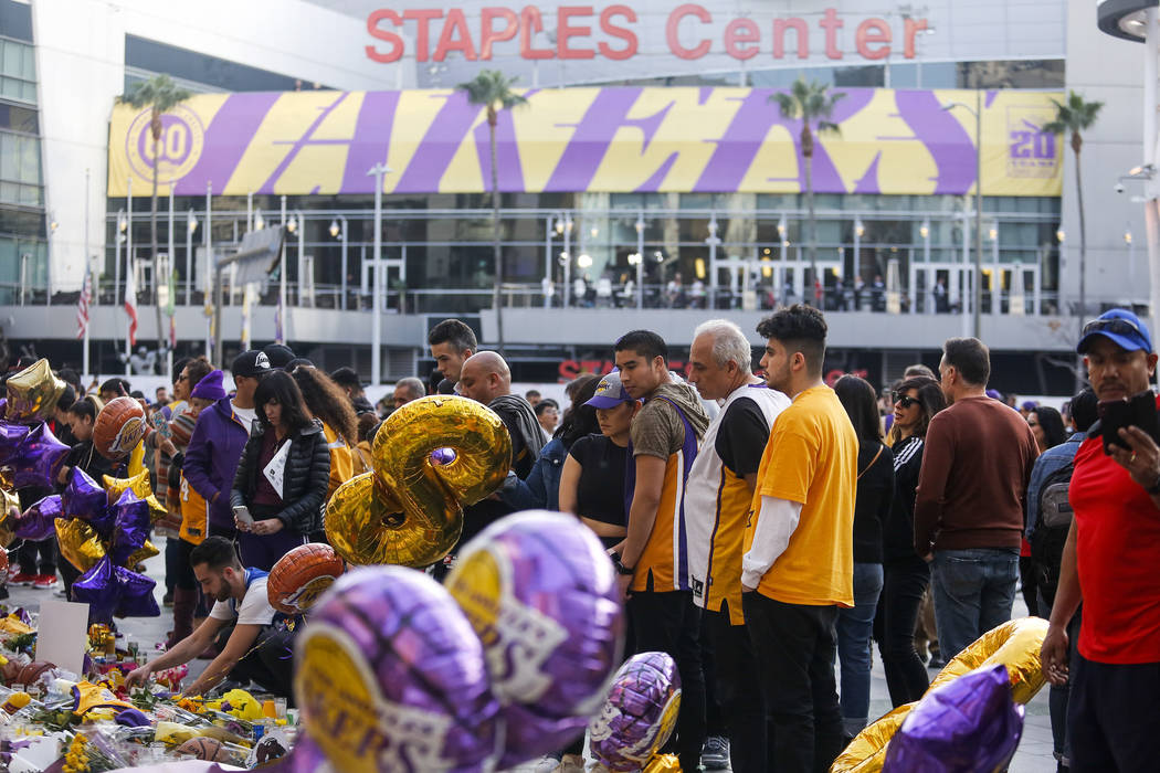 Fans gather to pay their respects at a memorial for Kobe Bryant in front of Staples Center, pri ...