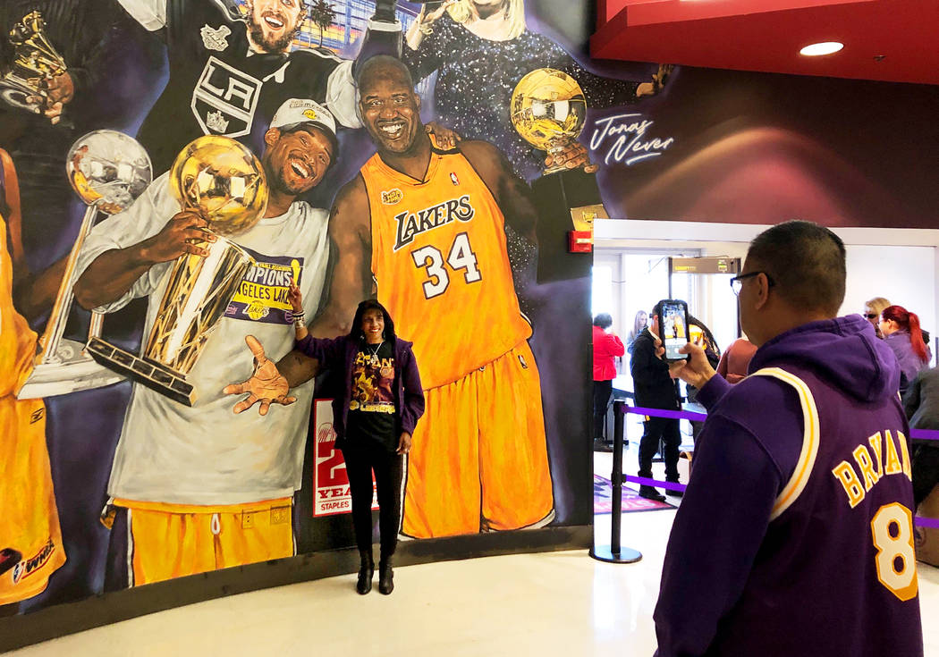 Janel Alexander, 55, of Encino, poses next to a mural that features Kobe Bryant and Shaquille O ...
