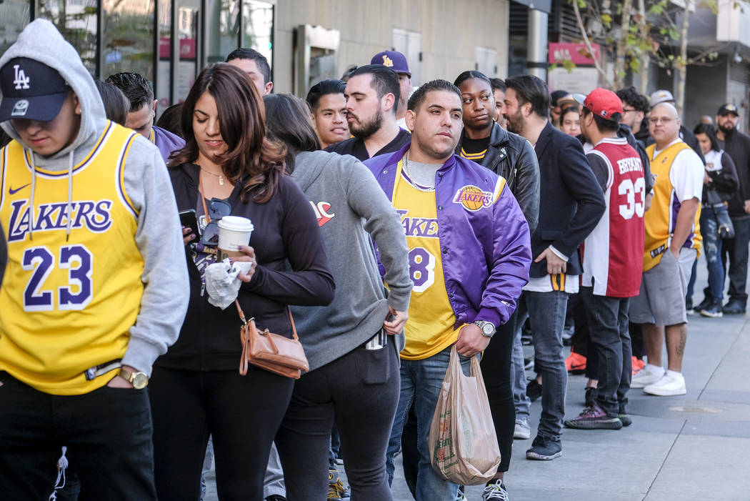 Fans line up to get into the Staples Center to attend a public memorial for former Los Angeles ...