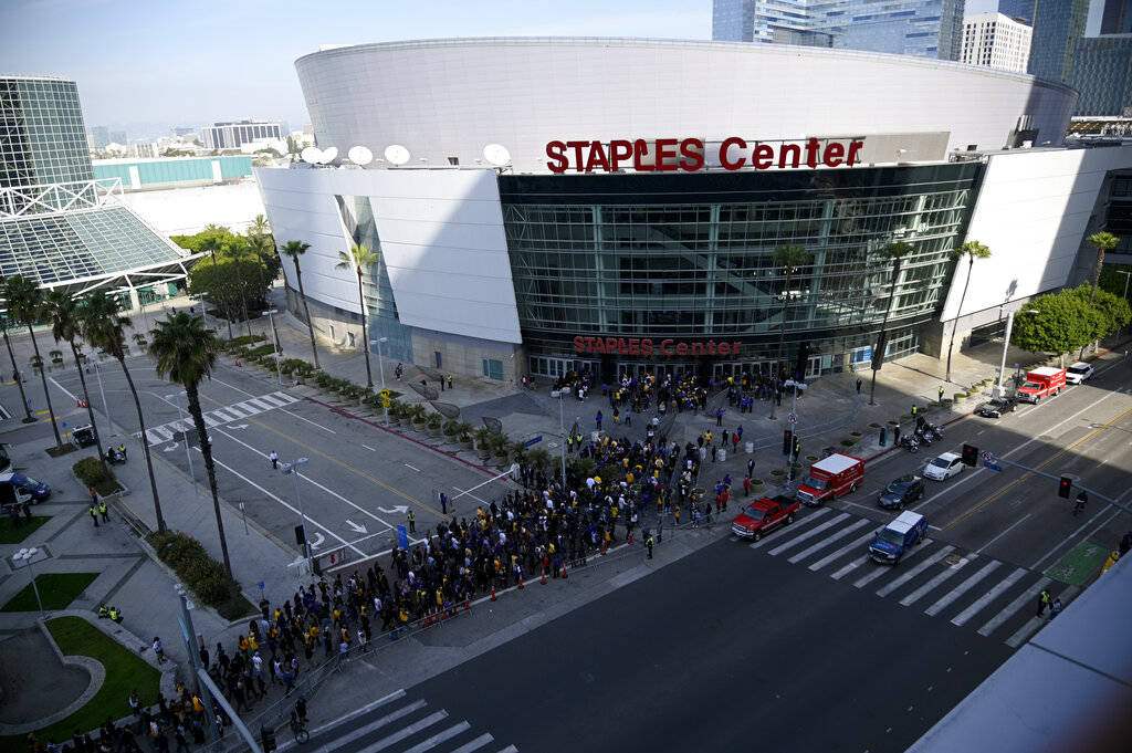 Fans line up to enter the Staples Center before a public memorial for former Los Angeles Lakers ...