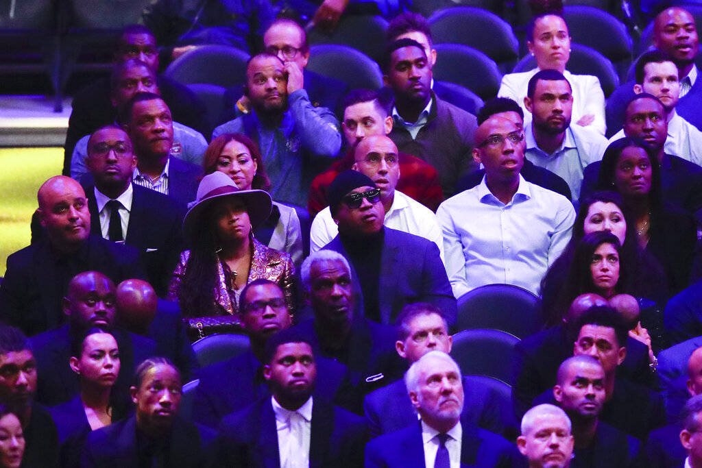 LL Cool J, middle, watches during a celebration of life for Kobe Bryant and his daughter Gianna ...