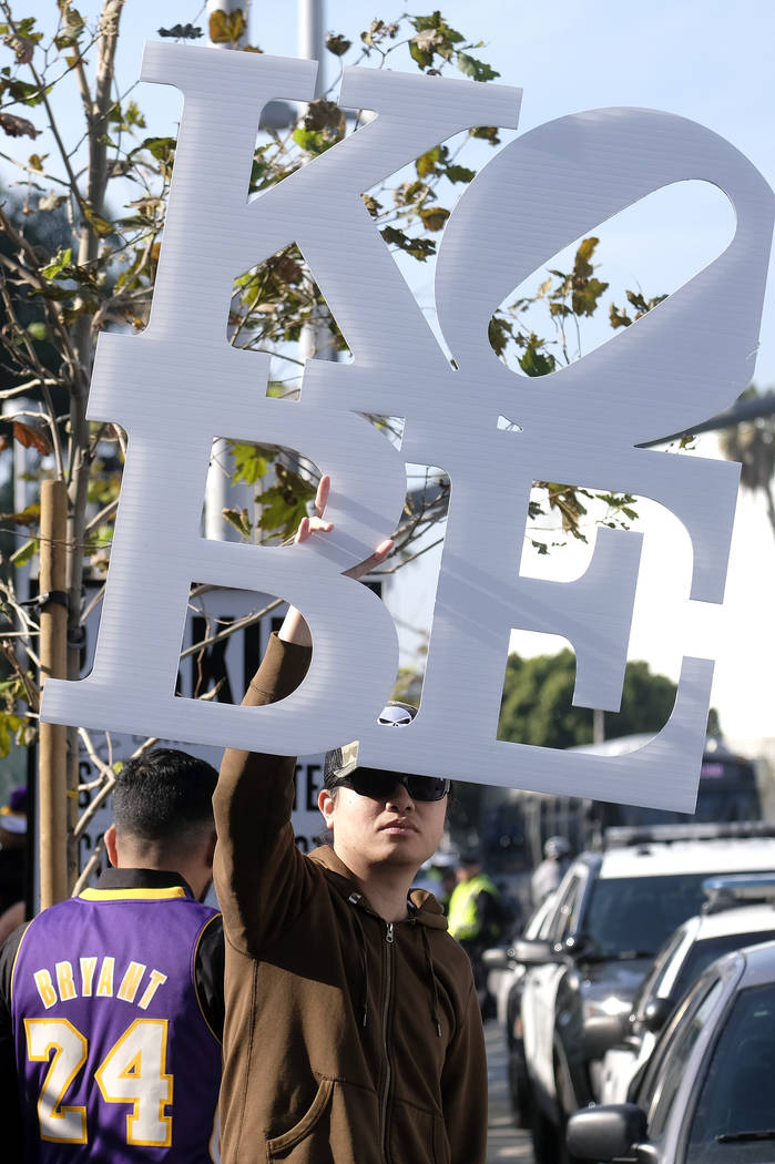 A fan holds a sign near the Staples Center before a public memorial for former Los Angeles Lake ...