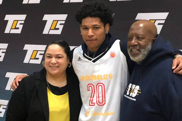 Trinity International Schools point guard Daishen Nix poses with his mother Mina Nix and coach ...