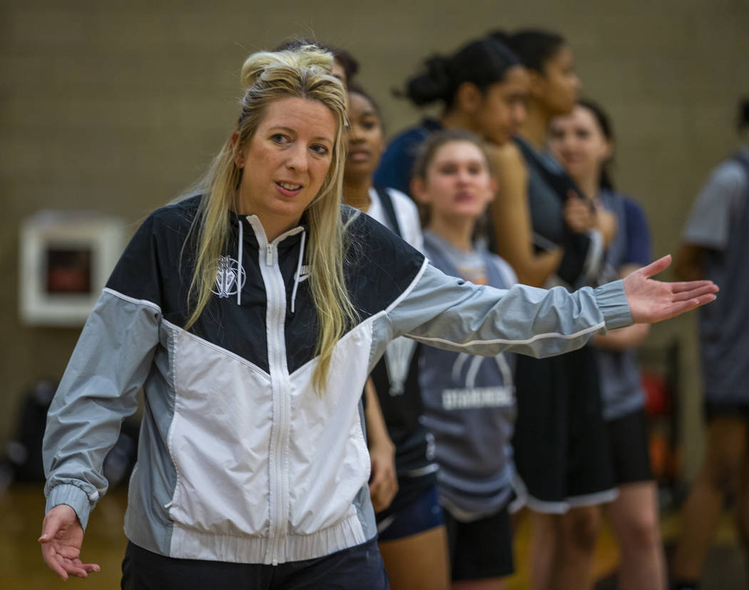 Head coach Laurie Evans, center, instructs some of her players during a Desert Oasis girl's bas ...