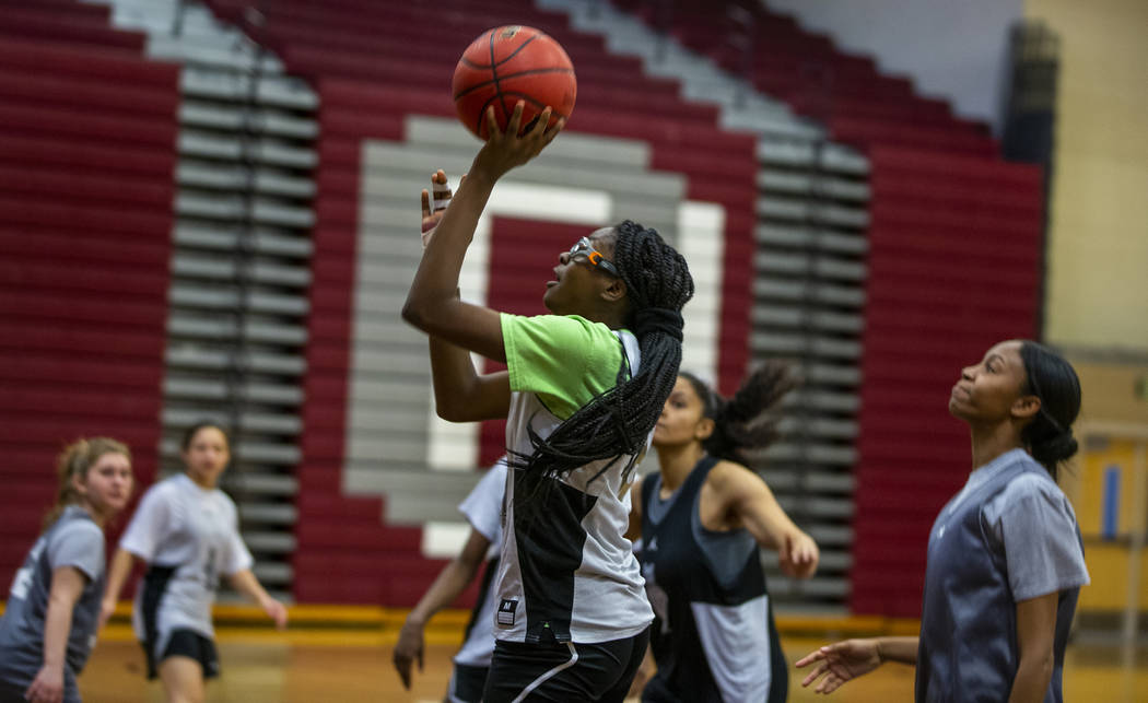 Player Jordan Stroud sets up a shot as the Desert Oasis girls basketball team practices on Mond ...