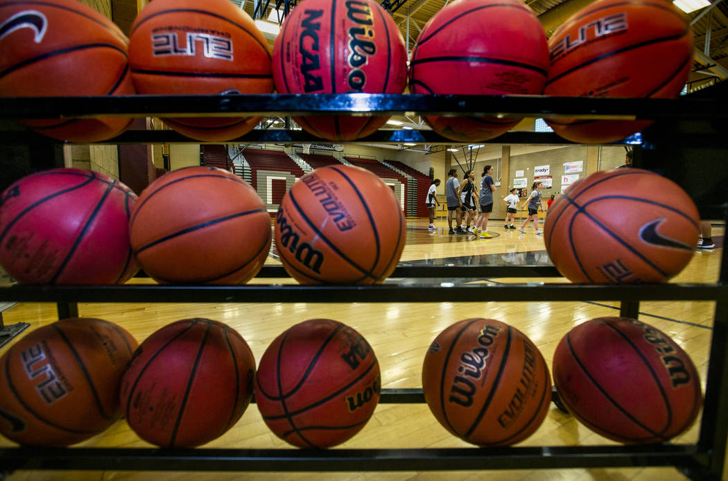 The Desert Oasis girl's basketball team players on the court during practice under head coach L ...
