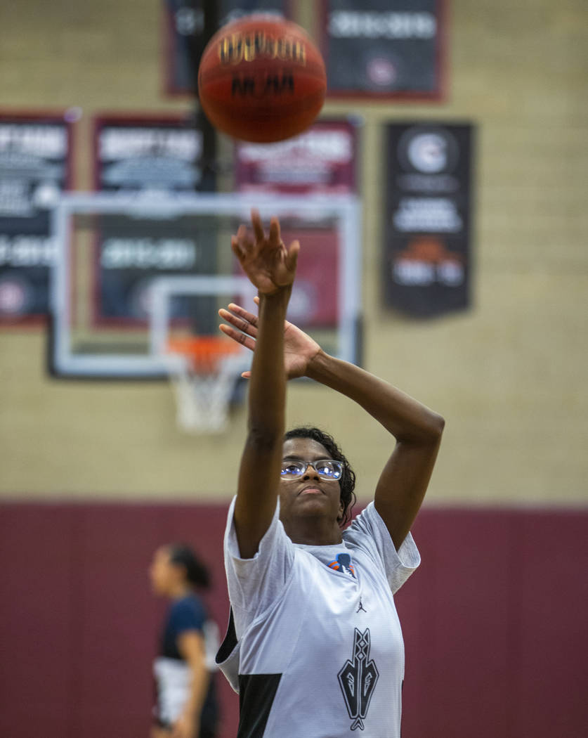 Player Desi-Rae Young shoots another free throw as the Desert Oasis girl's basketball team prac ...