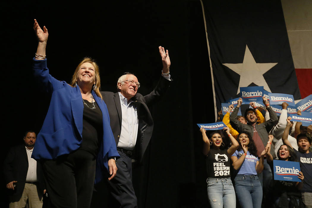 Democratic presidential candidate Sen. Bernie Sanders I-Vt. takes the stage with his wife Jane ...