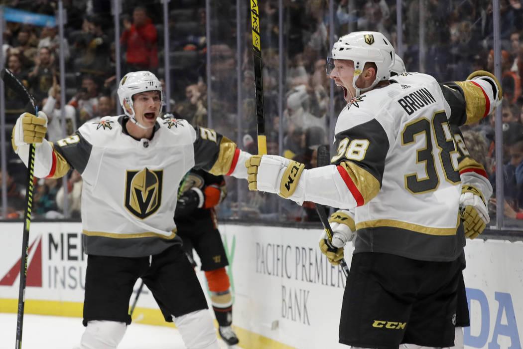 Vegas Golden Knights center Patrick Brown, right, celebrates with defenseman Nick Holden, left, ...