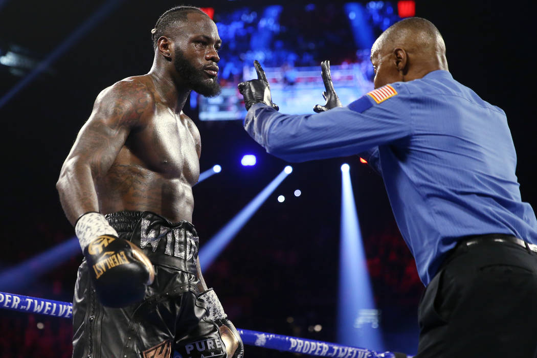 Deontay Wilder gets a count after getting knocked down by Tyson Fury in round 3 of the WBC worl ...
