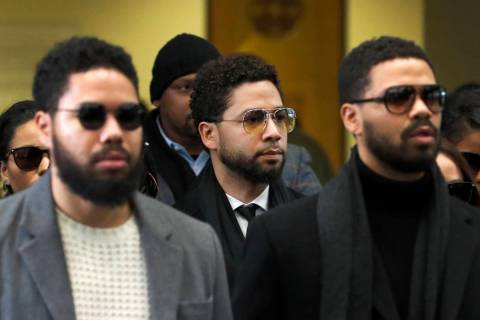 Actor Jussie Smollett, center, departs after an initial court appearance at the Leighton Crimin ...