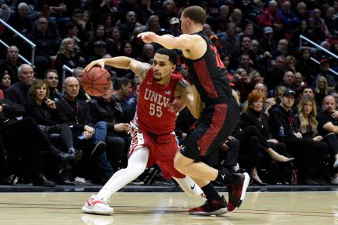UNLV guard Elijah Mitrou-Long (55) plays San Diego State guard Malachi Flynn (22) during the se ...