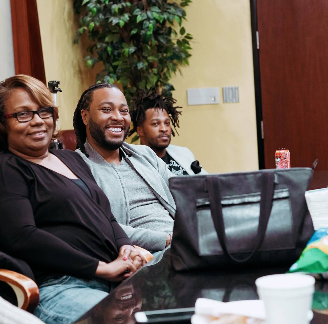 Rhonda Nolan, Kelvin Bell and Marcus Miller plan the final round of Native Son Spelling Bee. (P ...