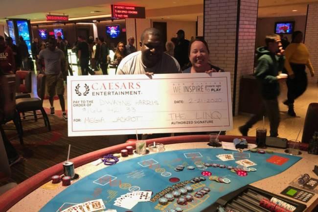 Dwayne Harris of Georgia celebrates winning $166,421 on a Three Card Poker mega jackpot Friday, ...