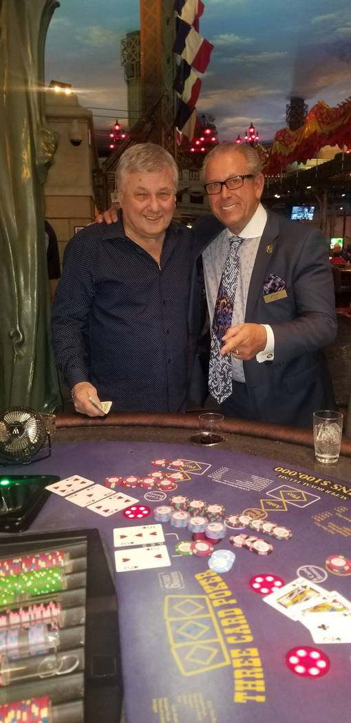 Jerry DeSimone, left, of Elmwood Park, Illinois, celebrates winnng for $108,337.05 on Three Car ...
