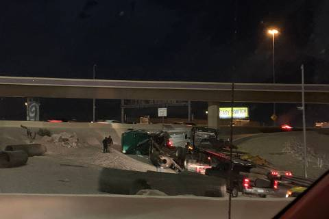 Police investigate a semitrailer rollover Monday, Feb. 24, 2020, on a ramp connecting U.S. High ...