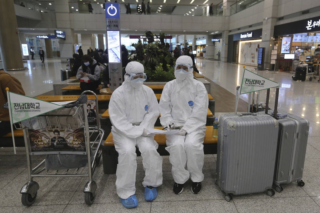 Chonnam National University staff wearing protective attire are on standby for special transpor ...