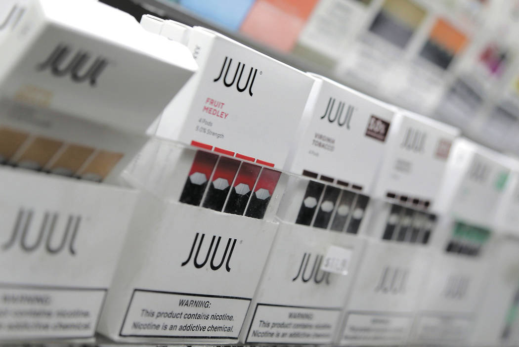 FILE - In this Dec. 20, 2018, file photo, Juul products are displayed at a smoke shop in New Yo ...