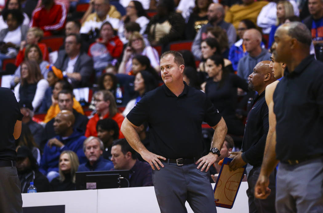 Bishop Gorman head coach Grant Rice watches as his team plays Coronado during the first half of ...