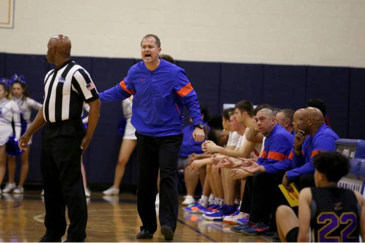 Bishop Gorman head coach Grant Rice argues a call in the third quarter of their basketball game ...