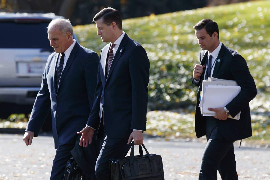 White House Chief of Staff John Kelly, left, walks with White House staff secretary Rob Porter, ...