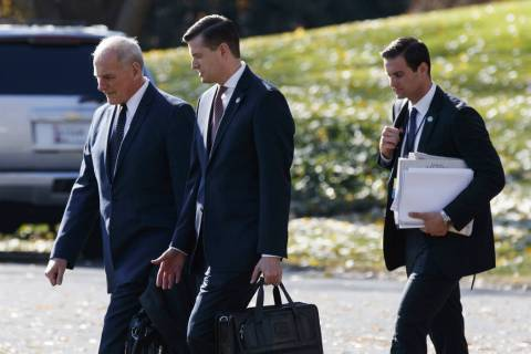 White House Chief of Staff John Kelly, left, walks with White House staff secretary Rob Porter, ...