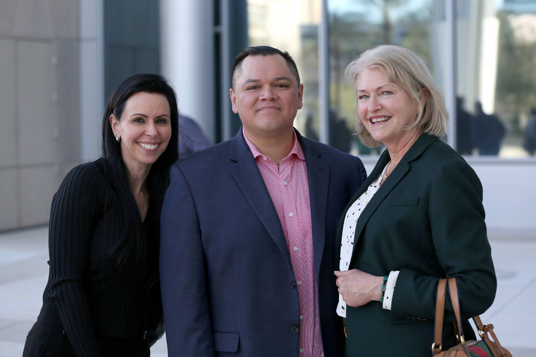 Attorneys Ivette Amelburu Maningo, left, and Kathleen Bliss stand with Diego Garcia, one of eig ...