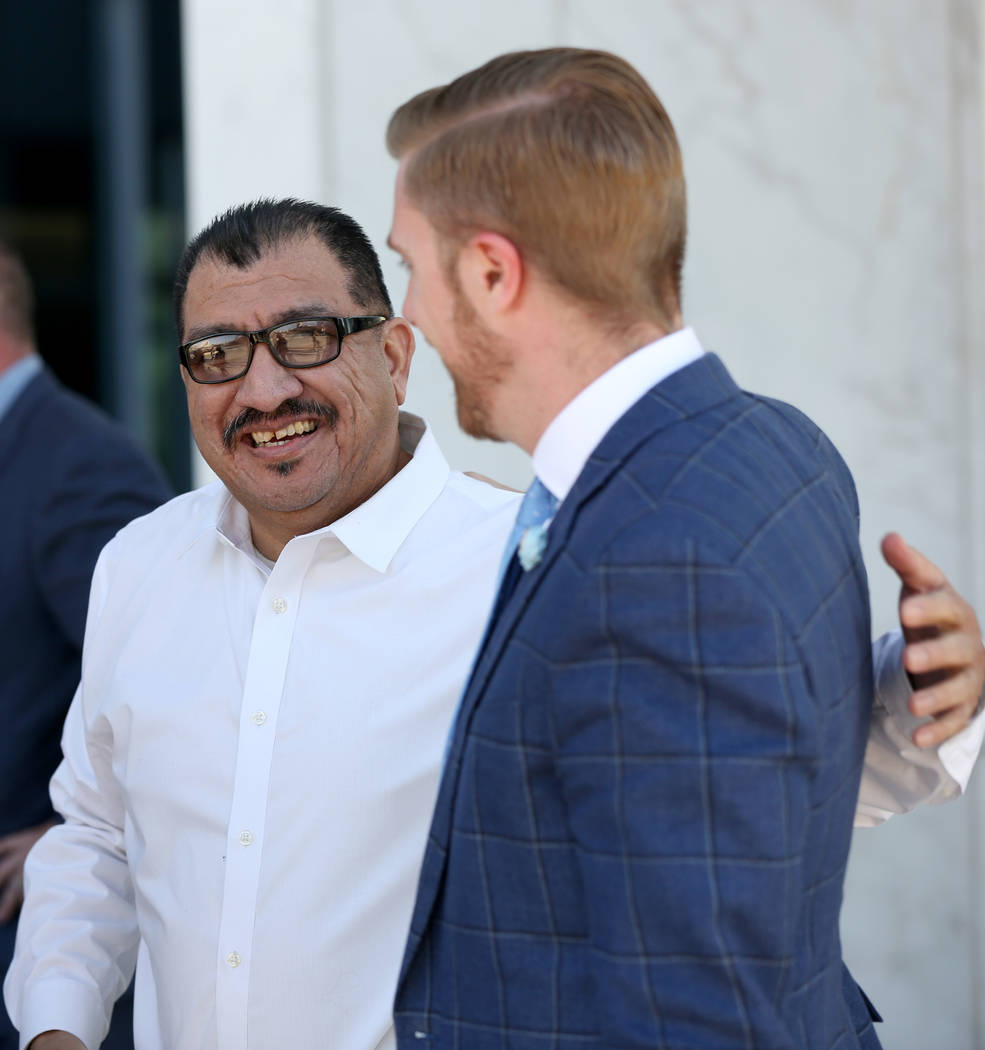 Pastor Palafox, left, greets attorney Dan Hill outside the federal courthouse in Las Vegas afte ...