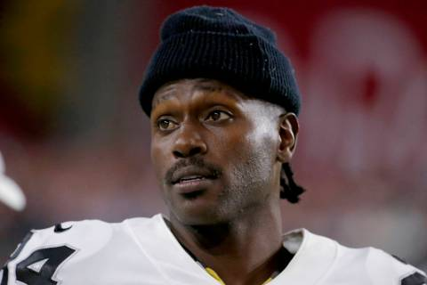 Former Oakland Raiders wide receiver Antonio Brown watches from the sidelines during the second ...