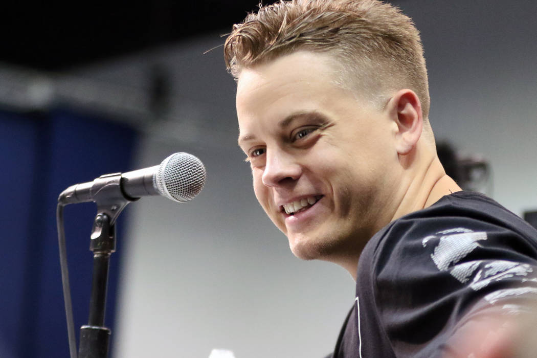 LSU quarterback Joe Burrow reacts to media questions at a news conference at the NFL scouting c ...